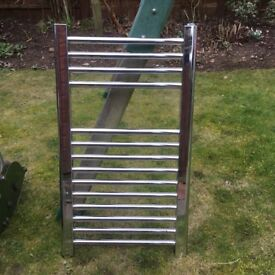 Aluminium coloured towel radiator. No valves attached.