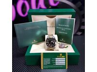 Two tone Rolex Submariner, black Face.  Comes Rolex Bagged, Boxed with Paperwork.