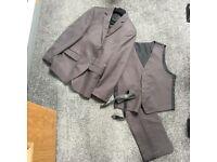 Grey suit , three piece with bow tie ,