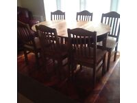 IKEA extendable pine dining table with 6 chairs.