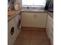 Galley kitchen units cupboards 3 towers beige Bosch dishwasher washing machine double gas oven &hob