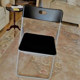 4 folding chairs in excellent condition,colour black with metal frames