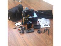 Nikon D5200, 18-55mm lens, Tripod, 3 batteries, manual, cleaning tool, shoulder bag