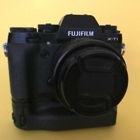 Fujifilm xt1, 35mm f1.4, battery grip, 4 batteries, 2 chargers + flash