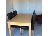 Table and 6 leather chairs, table extends with folding centre piece £100 for the set