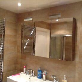 Bathroom furniture, sink unit, mirrored wall unit & tall storage cabinet.