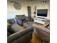 3 grey luxury sofas and footstool