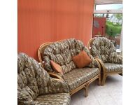 Conservatory sofa and two chairs with cane coffee tables in good condition. Must be uplifted
