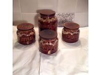 Biscuits, tea, coffee, sugar.pottery canisters