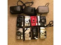 Nine old 35mm cameras and accessories.