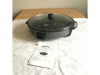 Electric cooking pan.