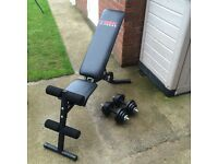 YORK FITNESS WEIGHTS/ SIT UP BENCH AND A SET OF SOLID BAR DUMBELLS WITH 25KG OF CAST IRON WEIGHTS