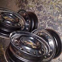 """4 - 5 bolt 215X16"""" steel rims 2- 3 yes old!"""