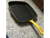Yellow cast iron griddle pan