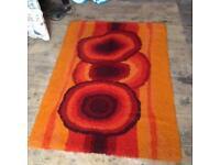 Orange and brown rug, carpet, with bold circular pattern, 70s, vintage