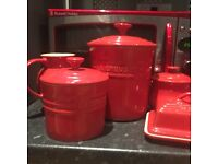 Red le creuset assorted items set, includes bread bin, butter dish, storage jar etc