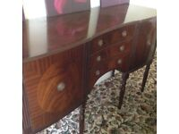 Dark wood sideboard with 2 cupboards and 3 centre drawers. Good condition