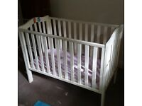 White baby cot in excellent condition, with barely used mattress