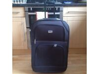 Large Soft Bodied Suitcase with wheels and pull along handle