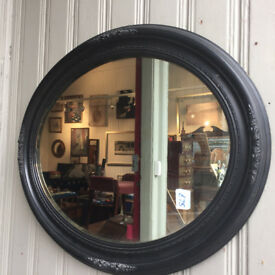 Mirror in good condition , great shape . Black frame with detail. size W 24in H 21in