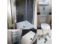 Bathroom suite. Vanity unit Sink, toilet, radiatior & shower cubicle