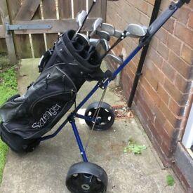 Slazenger golf clubs, bag, trolley.