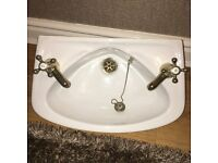 Cloakroom sink with taps