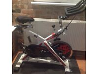 Spin bike, heavy fly wheel, used a handful of times!!! 5* reviews!