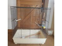 Parrot cage - large with plastic tray and food holders and 3 perches.