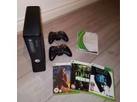 Xbox 360 bundle with games, guitar and drums