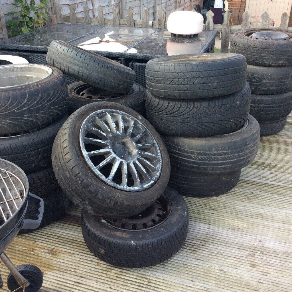 FREE TO COLLECTOR 18 WHEELS RIMS AND TYRES SOME HARDLY USED ASSORTED SIZES