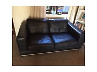 Two Black Patent Leather Sofas