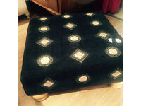 Large Foot stool covered in Versace Material Very good condition, very comfortable.