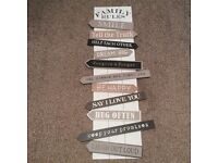 Large wooden 'family rules' picture