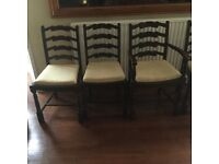 Dark wood dining table and 2 carver 4 chairs 6 in total