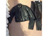 Childs black motorbike jacket and trousers set age 9-10 years