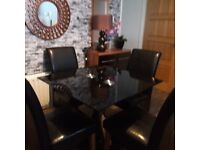 Black glass table and 4 leather chairs
