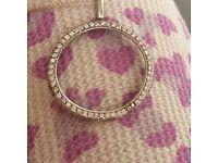 Diamond circle pendant on fine chain