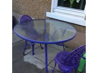 Purple metal garden table and chairs for sale £50 ono