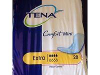5 packs of 28 --- Tena comfort mini extra