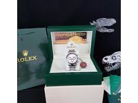 silver Rolex Daytona with silver face black bezel with al silver oyster strap comes in Rolex box&bag