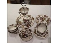 Floral design vintage cake stand with four matching cups, saucers and cake plates.