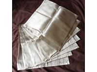 "8 x silver grey fabric napkins in sheer silk type fabric. Size of each is 18"" x 18"" square"