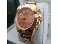 Champagne faced Rolex Daytona with gold Bezel and all gold oyster bracelet. Comes with rolex box&bag