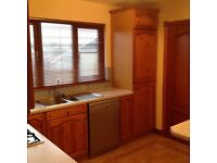 Full kitchen including integrated fridge freezer, dishwasher oven and hob. Breakfast bar and stools