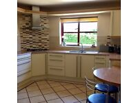 A fully working modern kitchen for sale, inc Siemans appliances, wooden cream doors. A Bargain!!!!