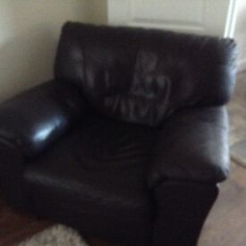 Brown leather arm chair in ammaculate condition must collect.
