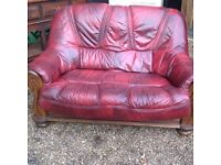 Two seater red leather sofa ....free local delivery
