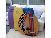 4 body boards and 3 skim boards wooden
