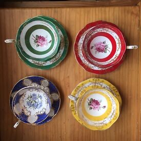 Four ornate cups and saucers
